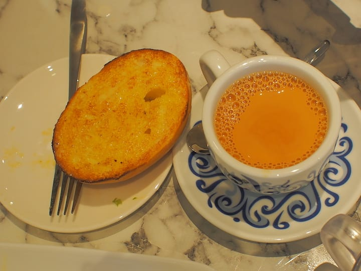 Two of Tsui Wah's signature dishes: condensed milk toast and milk tea.