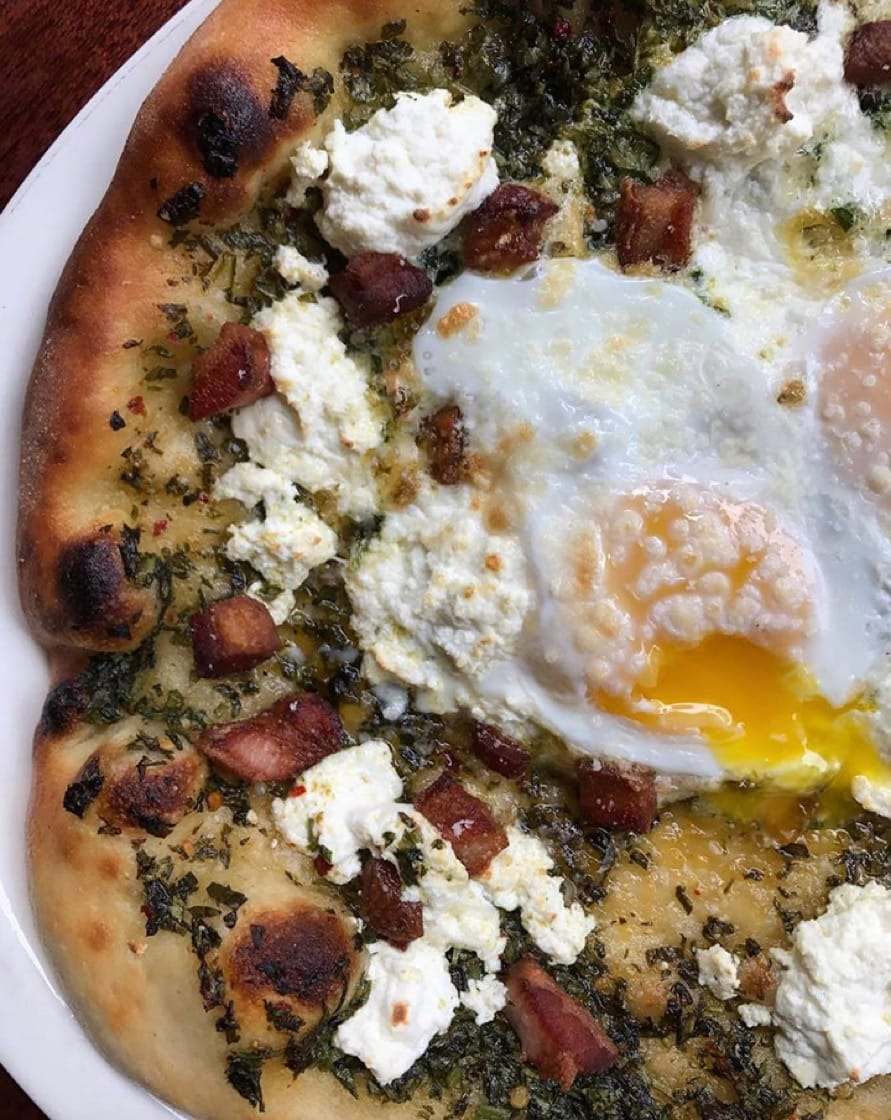 The breakfast pizza at Barbuto is topped with baked eggs, salsa verde, straciatella and pancetta. (Photo: Barbuto Facebook page.)
