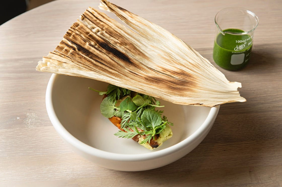 Charred carrot tamal with green garlic and 'hoja santa' mole at Oxomoco in Brooklyn. (Photo by Evan Sung.)