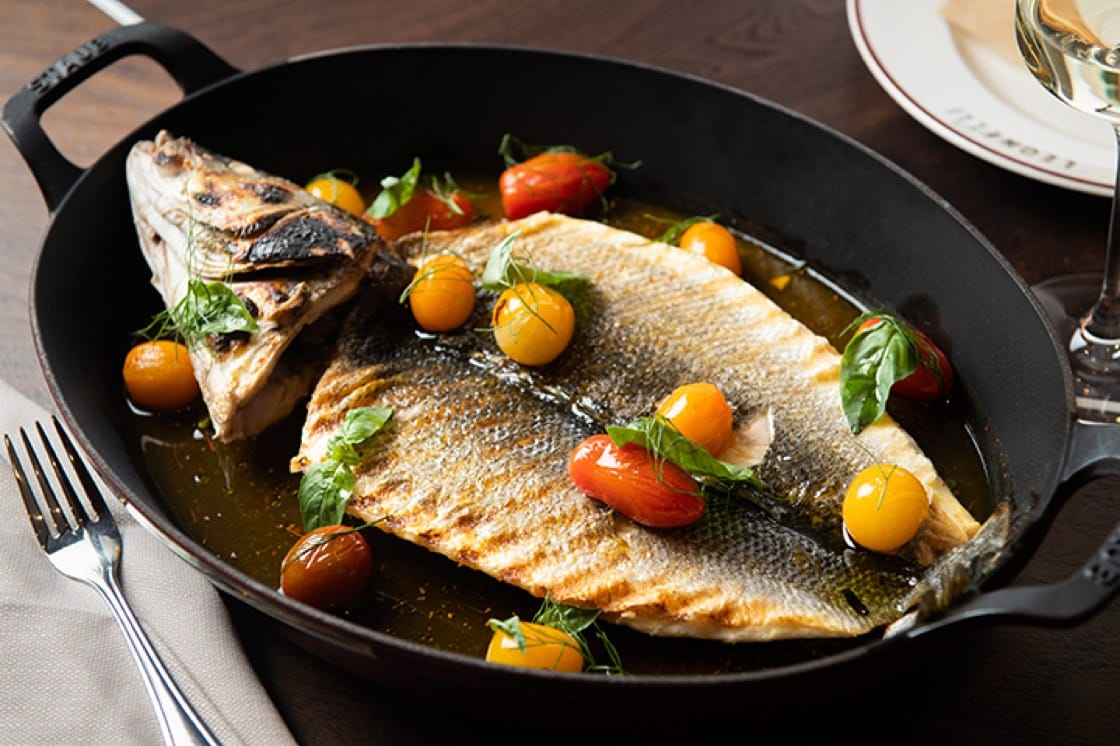 Branzino 'all'acqua pazza'—whole sea bass with fennel, cherry tomatoes and saffron broth.