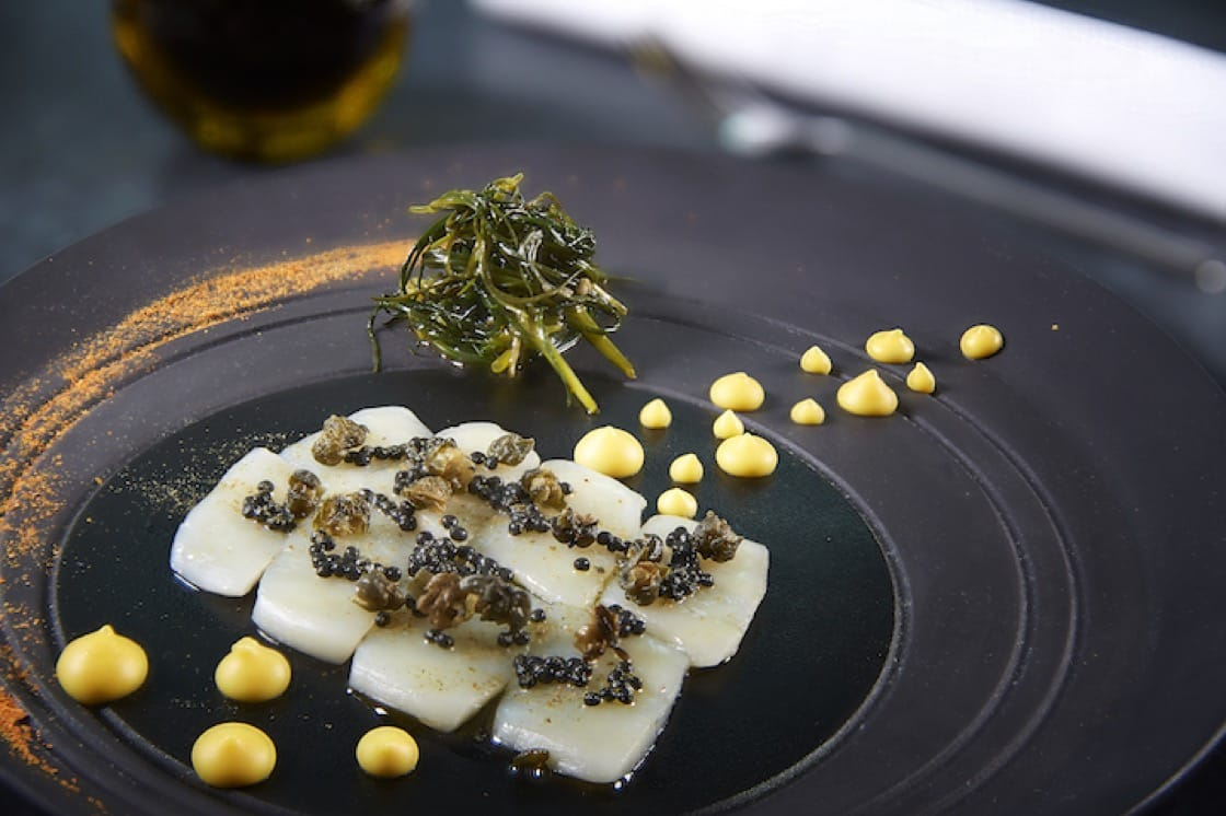 Antipasti of Hokkaido scallops rimmed with piquant capers powder (Pic: SoloStep Studio)