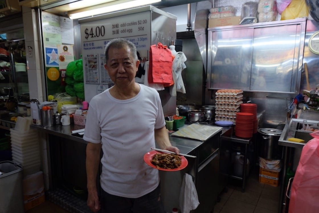 Outram Park Fried Kway Teow Mee's Ng Chin Chye has been frying char kway teow for the past 18 years. (Credit: Kenneth Goh)