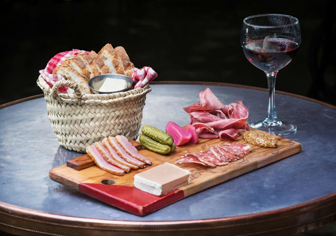 Charcuterie at the bustling Au Comptoir. (Photo courtesy of Au Comptoir.)