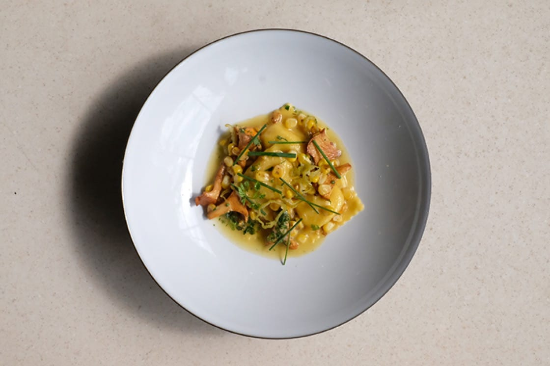 Boulud Sud serves a sweet corn agnolotti with chanterelle mushrooms, shishito peppers, and Parmigiano-Reggiano. (Photo courtesy of Boulud Sud.)