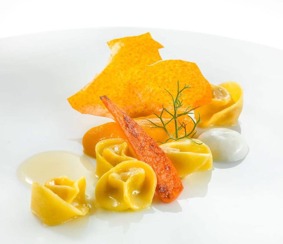 Rabbit tortellini with carrot and chamomile. (Photo courtesy of Heinz Beck's Facebook page.)