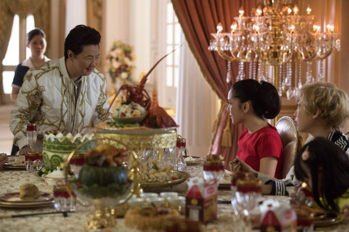 The Goh family feast featured 12 to 15 dishes from lobster and chicken rice to a soup in a carved winter melon bowl. (Credit: Warner Brothers.)