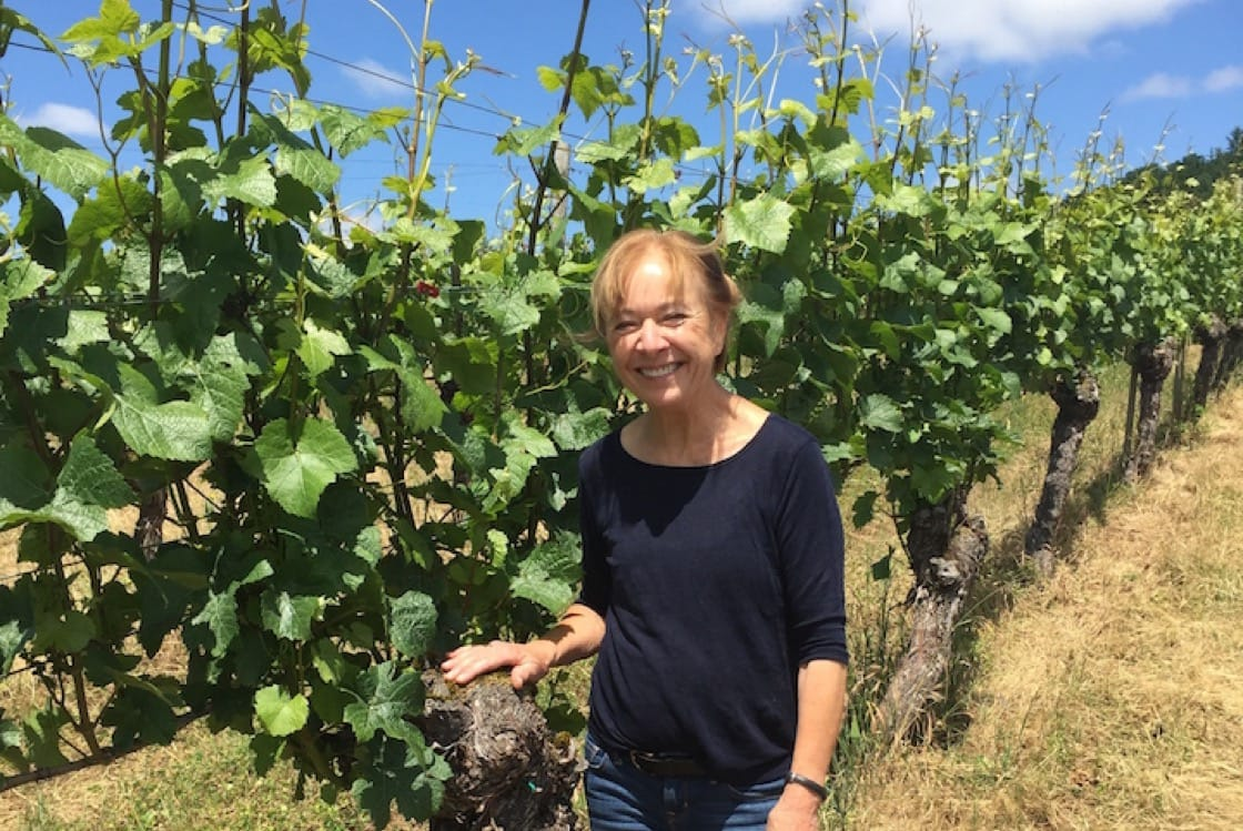 As a wine reviewer, Brooks spends her days visiting wineries and speaking to winemakers like Pat Dudley (pictured) of Bethel Heights. (Photo by Erin Brooks.)