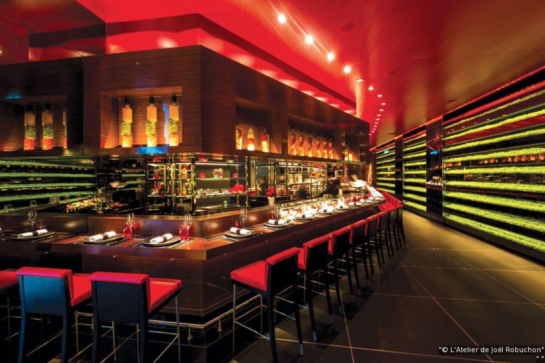 The signature red interiors of L'Atelier de Joel Robuchon (Pic: L'Atelier de Joel Robuchon)