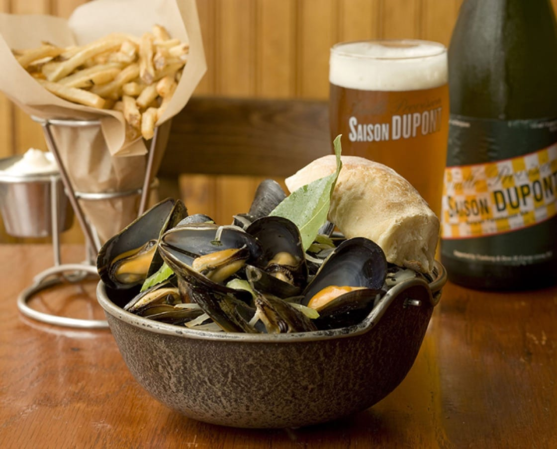 At Hopleaf, mussels are steeped in beer, Belgian-style, or sautéed with San Marzano tomatoes and fennel, and topped with fresh corn. (Photo courtesy of Grant Kessler/Hopleaf.)