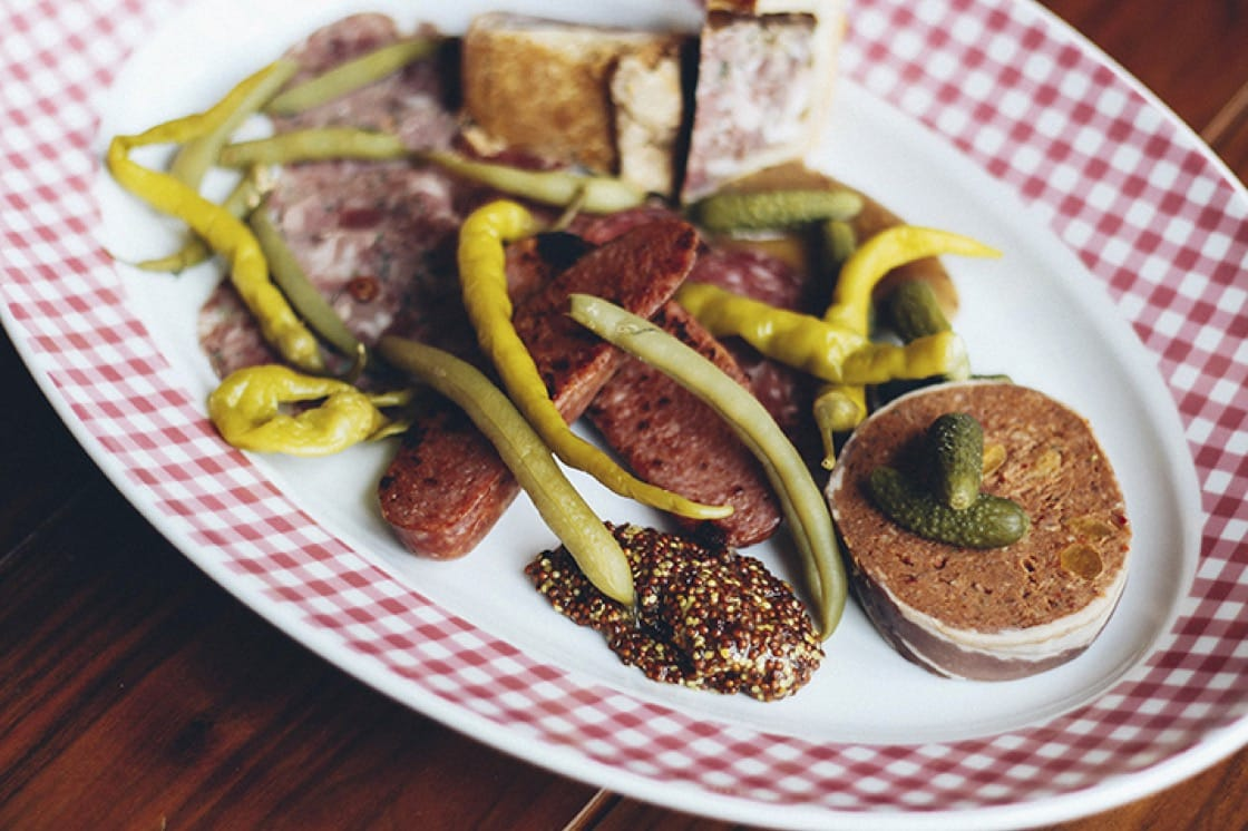 The charcuterie plate at The Publican features Spanish chorizo, pork pie, head cheese, pâté and pickled vegetables. (Photo courtesy of Chloe List/The Publican.)