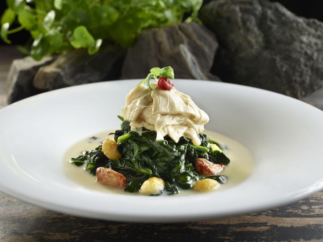 Poached Australian baby spinach with fresh beancurd skin, ginkgo and whole garlic (Credit: Crystal Jade)