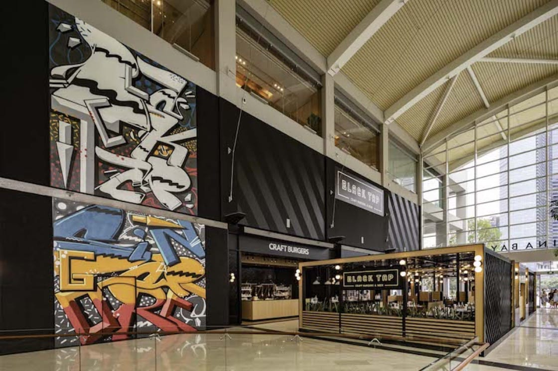 Black Tap is flanked by a visually arresting graffiti mural by local graffiti artist Has.J. (Photo courtesy of Marina Bay Sands.)
