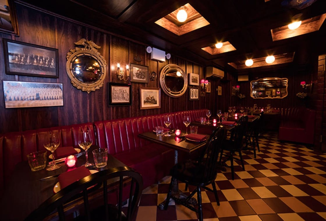 The restaurant's mahogany interior pays homage to historic New York steakhouses like 21 Club and Keens. (Photo by Robert Malmberg.)