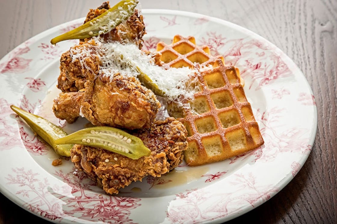 Chicken and waffles with legs and thighs, Bourbon maple syrup, pickled okra and aged Manchego. (Photo courtesy of Succotash.)