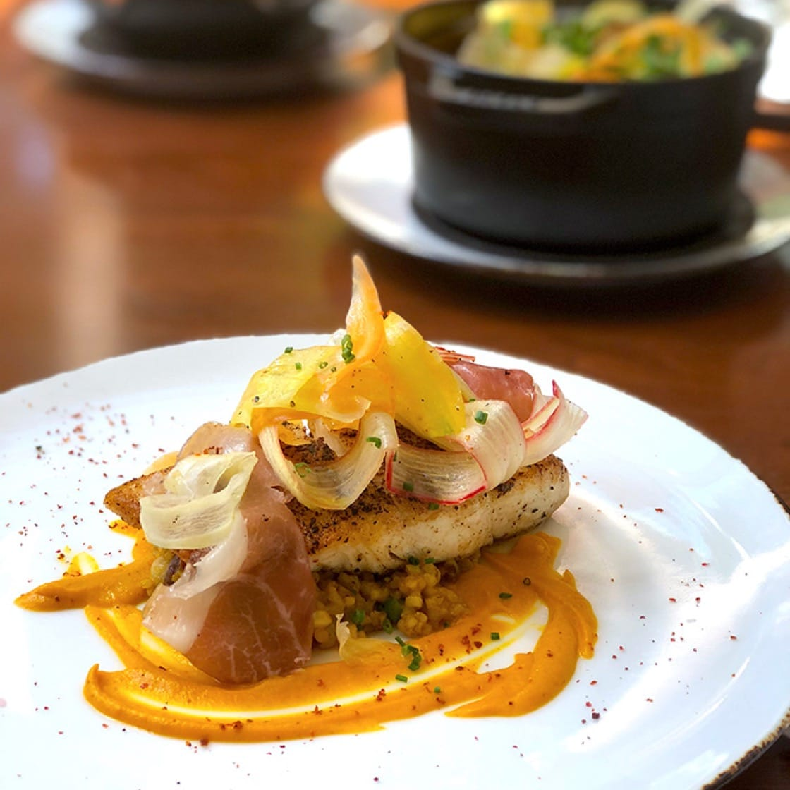 Spice-roasted halibut with Carolina Gold broken rice pirlau, heirloom carrots, country ham, rhubarb and boiled peanuts. (Photo by Lani Furbank.)