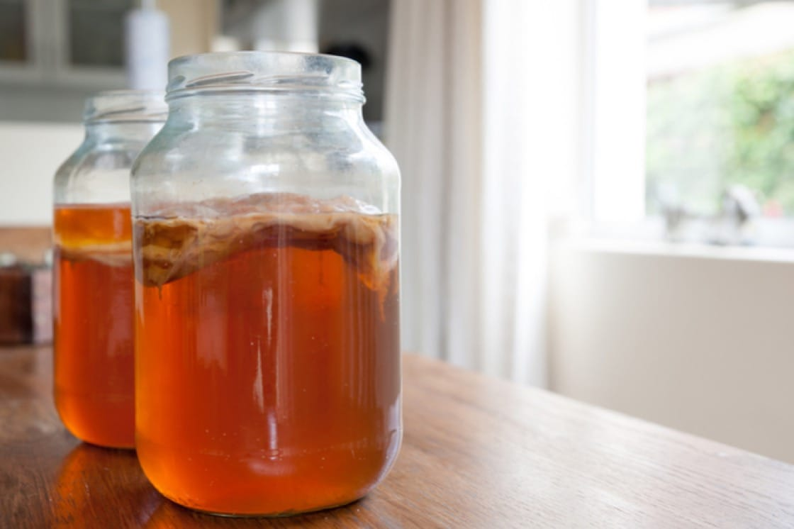 The first fermentation stage happens in a wide-mouthed glass jar covered with cloth to allow air-flow.