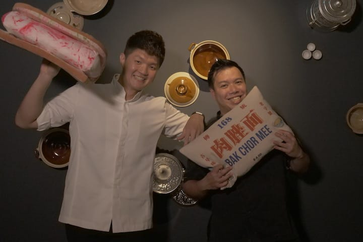 Chef Jimmy Lin (left) thinks that Chef Han Liguang is like bak kut teh, while Han thinks than Lin is like char siew. (Credit: MICHELIN Guide Digital)