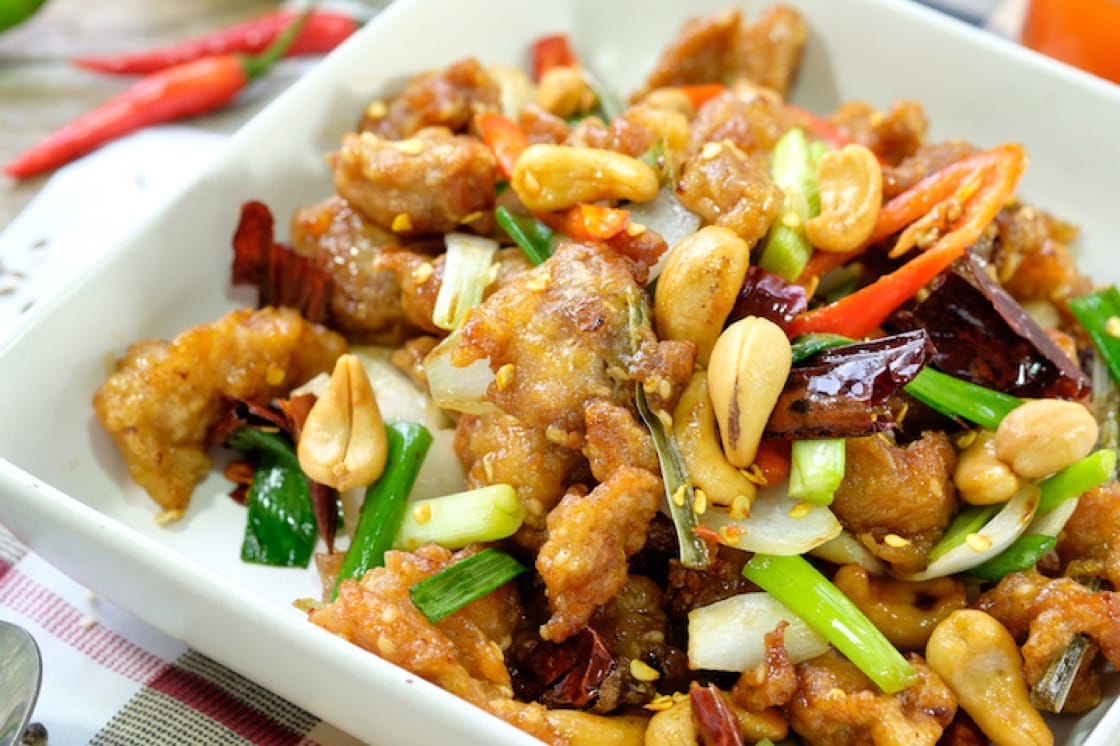 Kung pao chicken boasts cubes of chicken that is stir-fried with peanuts, Shaoxing wine, vegetables and Sichuan peppercorns.