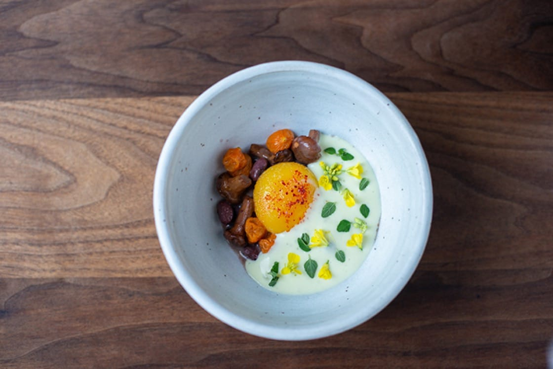Rana roja beans with egg yolk, sungold tomatoes and chanterelles.