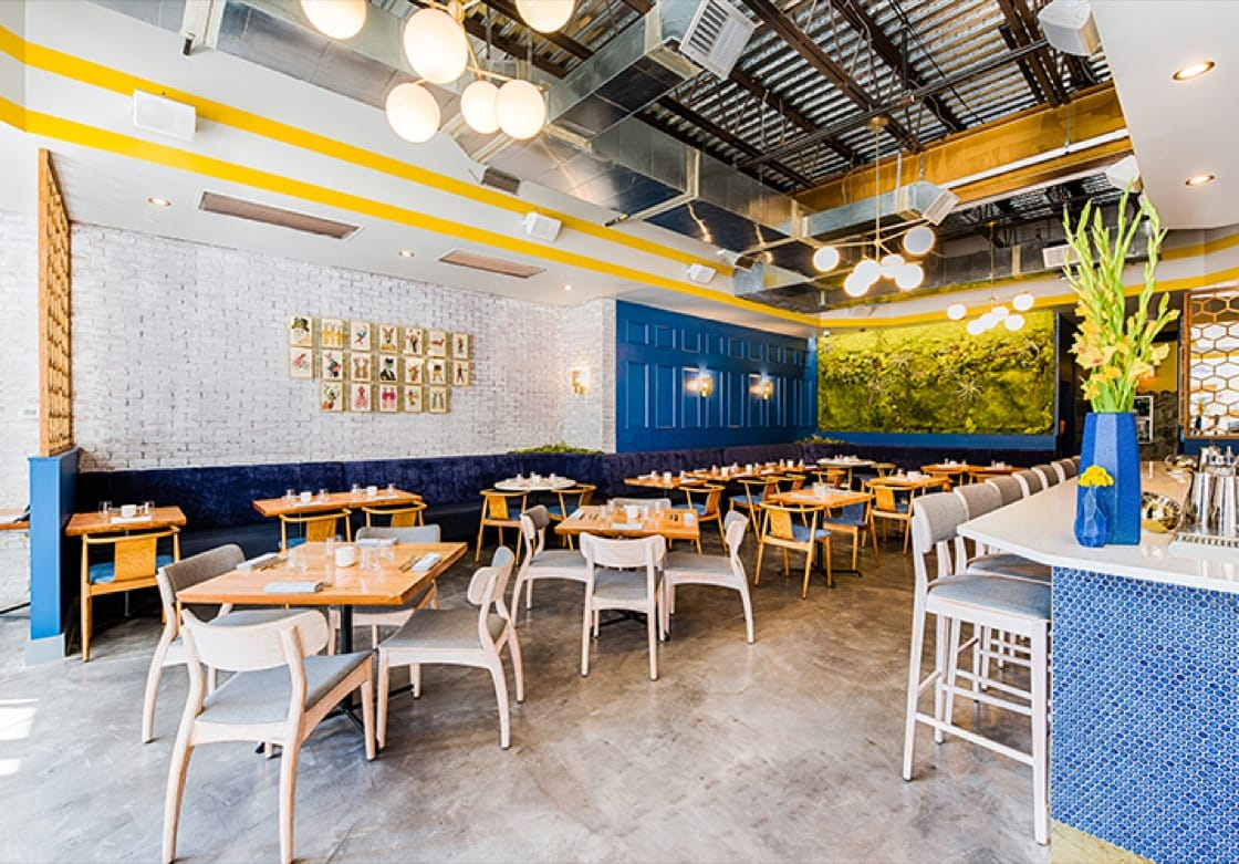 """""""Inside, whitewashed brick, a living wall crafted of moss and quirky decorative elements create a contemporary ambience, while an amiable staff tends to every detail,"""" say Michelin inspectors of Bresca."""