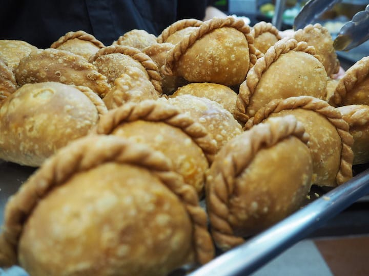 Rolina's curry puffs may be small, but the thin-crusted puffs pack a spicy punch as they are filled with rempah. (Credit: Kenneth Goh)