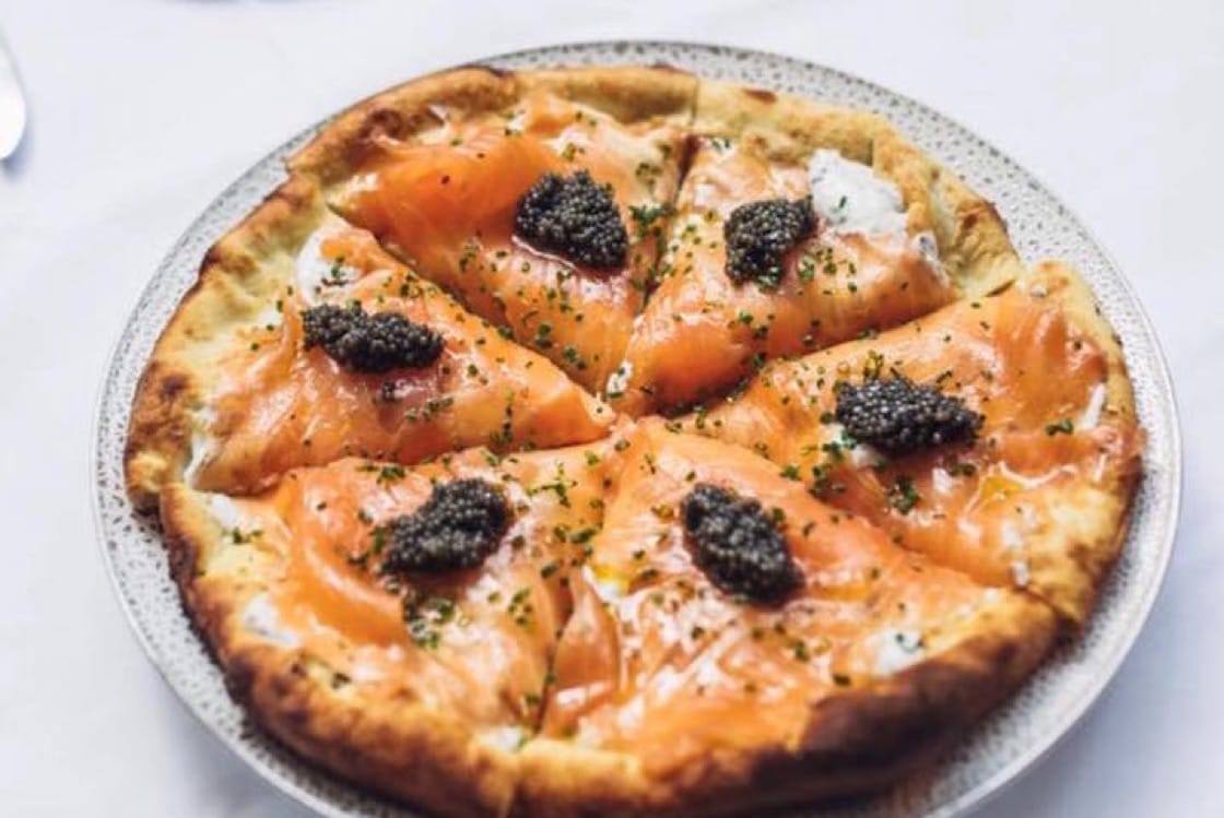 Spago's famed smoked salmon pizza. (Photo courtesy of Spago Beverly Hills Instagram.)