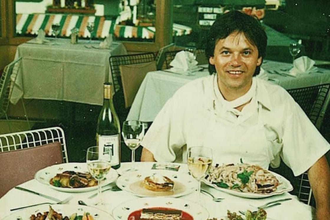 A young Wolfgang Puck in the early days of Spago (Photo courtesy of Spago Beverly Hills Instagram.)