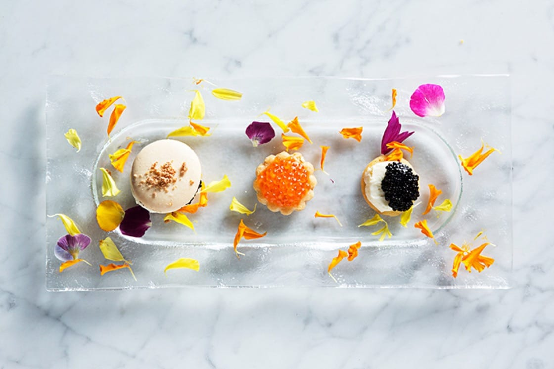 "The caviar cookie trio at Siren by RW is a play on the ""black & white,"" macarón and linzer cookies. (Photo by Scott Suchman.)"