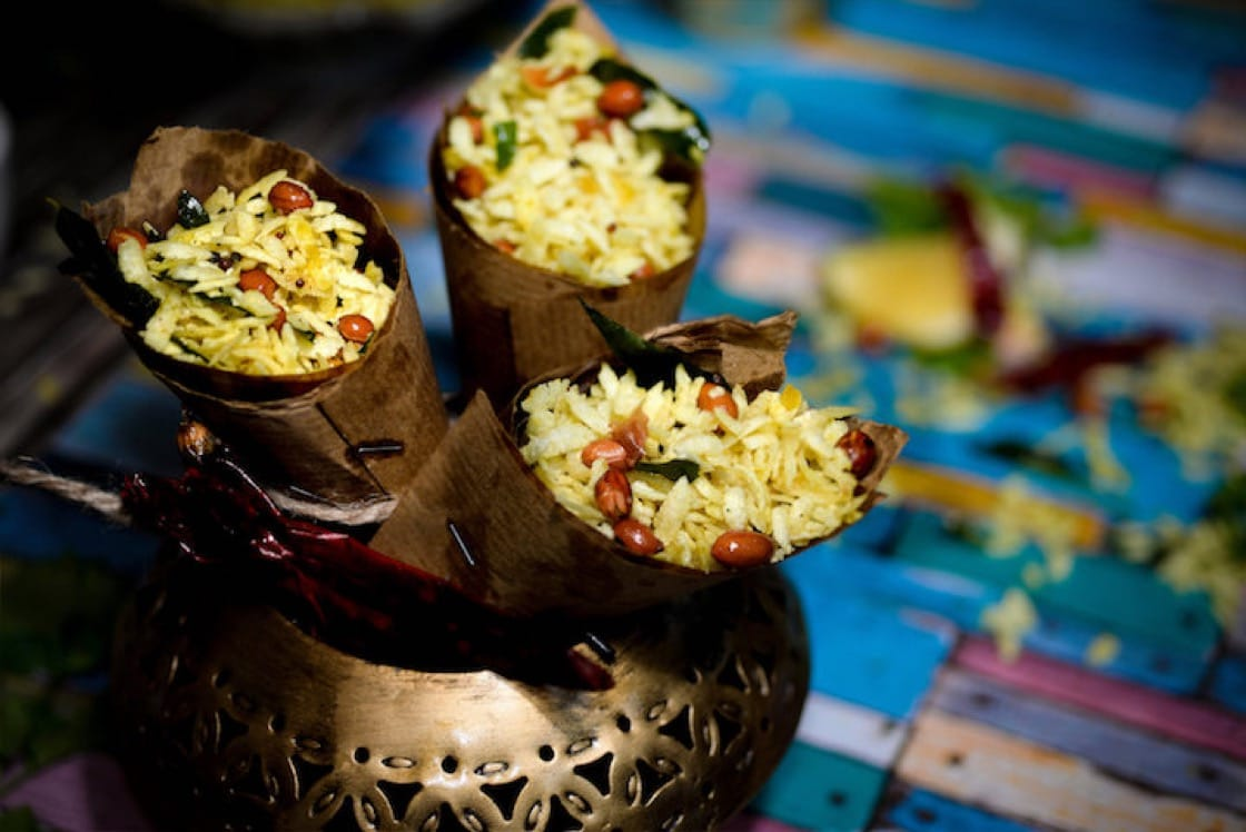 Masala chivda is a savoury snack made with fried flattened rice flakes, raisins, peanuts and spices. (Credit: Punjab Grill)