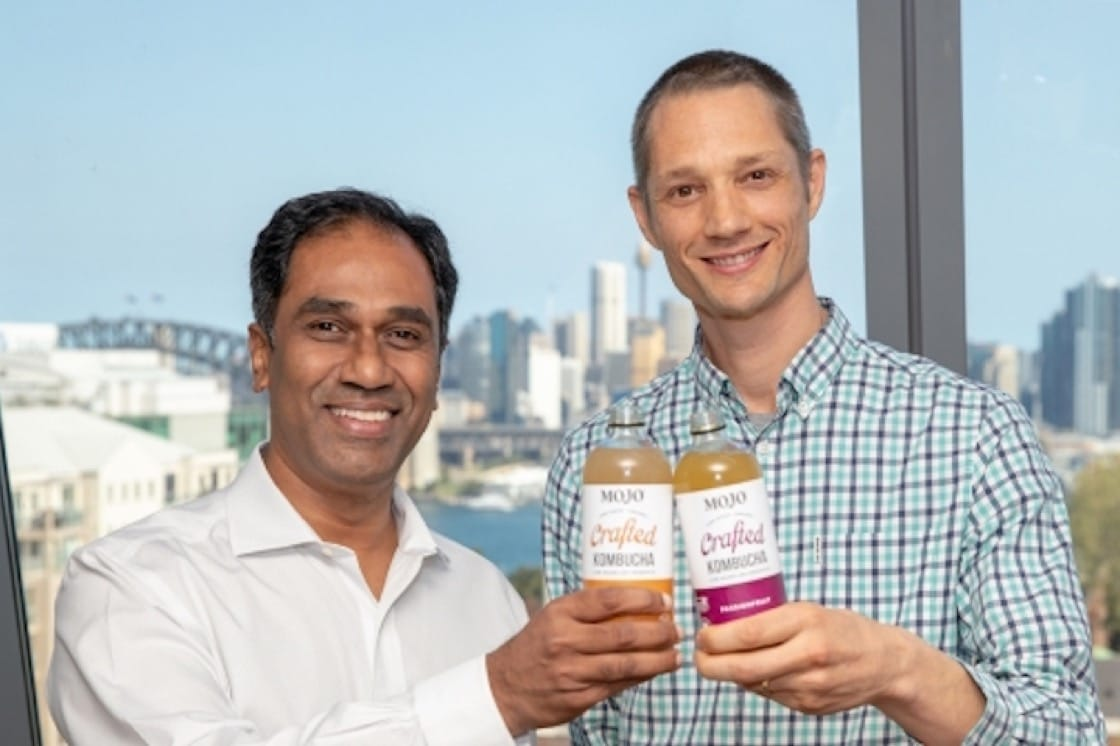 Vamsi Mohan (left), president, Coca-Cola Australia, and Anthony Crabb, co-founder and CEO, Organic & Raw which runs the MOJO brand. (Pic: Coca-Cola Company Website)