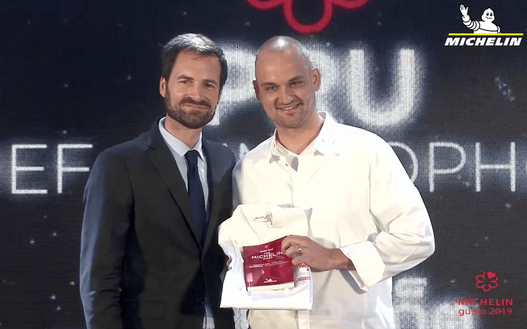 PRU's head chef Jimmy Ophorst receiving the restauran's one-star accolade from Gwendal Poullennec, International Director of the MICHELIN Guides.