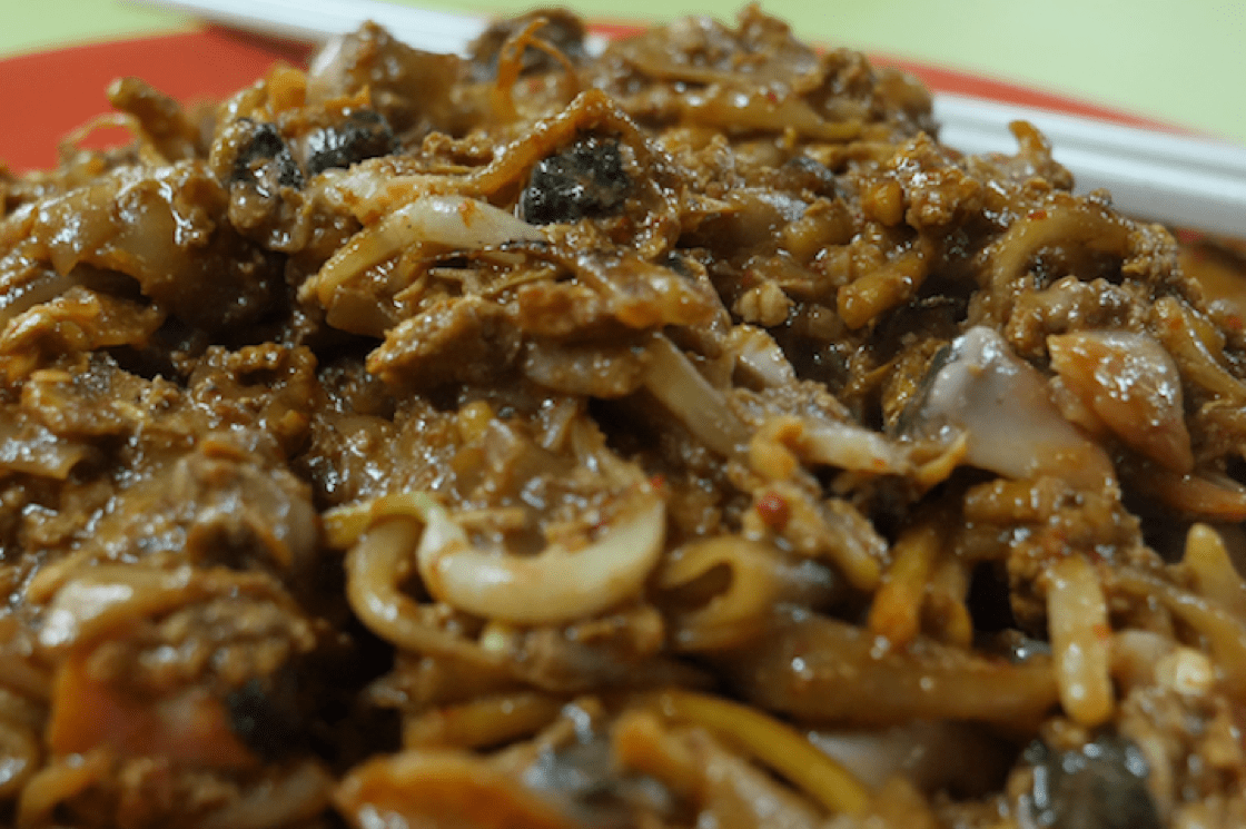 Each smoky plate of char kway teow is covered with beaten egg and studded with beansprouts, cockles and pork lard (Pic: MICHELIN Guide Digital)