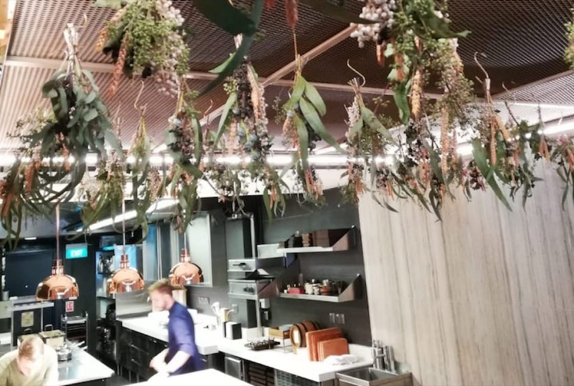 Overlooking the kitchen in level 1 are dried flowers and herbs and a block of cured pork. (Credit: Kenneth Goh)