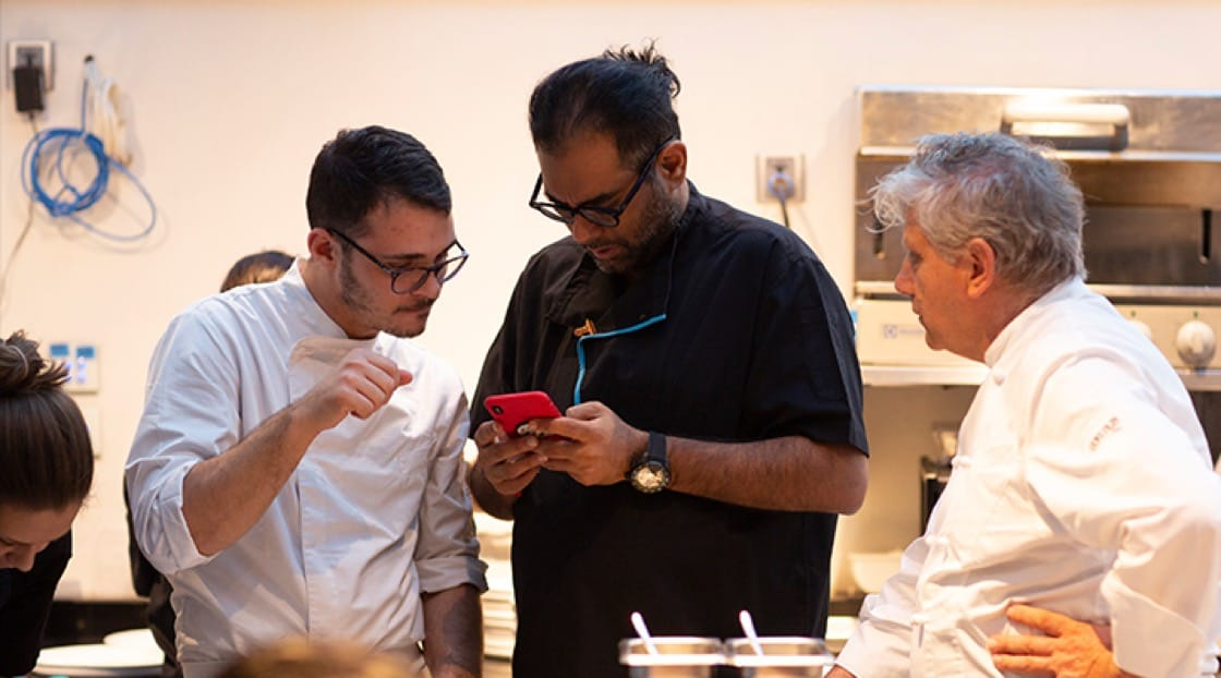 Chef Gaggan Anand (middle) during a collaboration session with Chef Antonio Mellino (right).