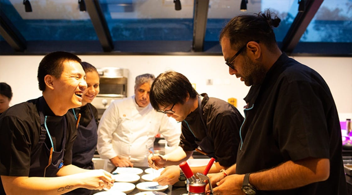Chef Gaggan runs the kitchen as a family and passes down his know-how to the younger generation.