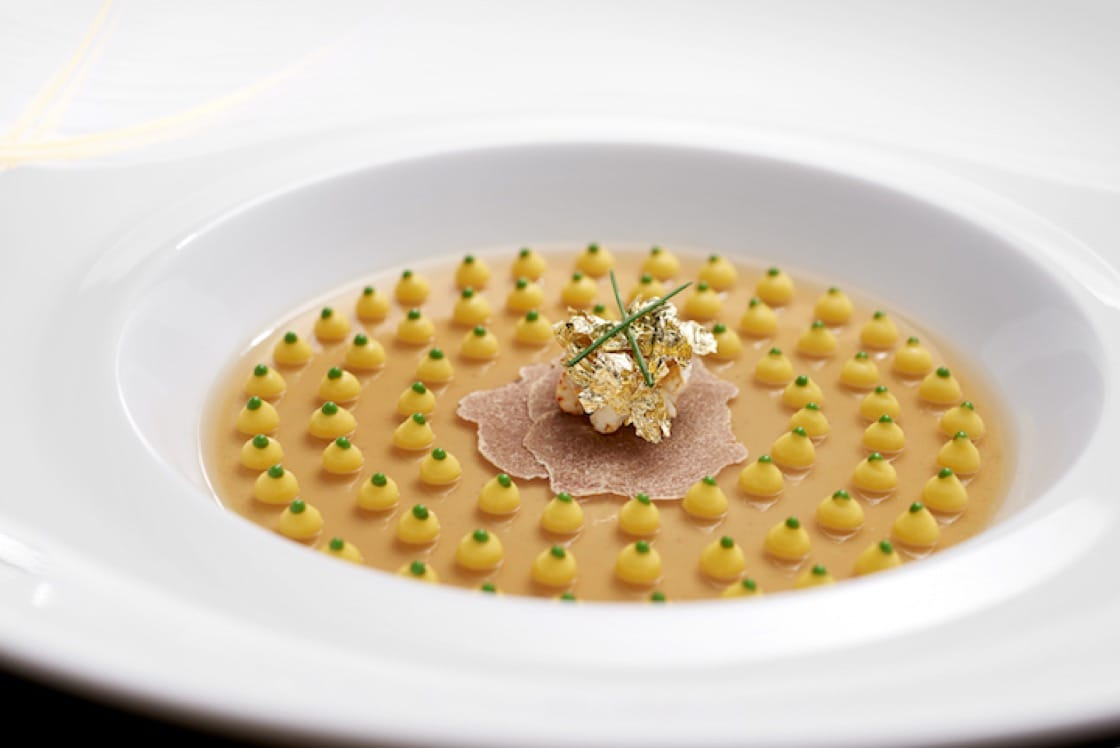 Foie Gras Symphony has dots of corn puree on a delicate foie gras and duck consomme jelly. (Credit: Bacchanalia By Vianney Massot)