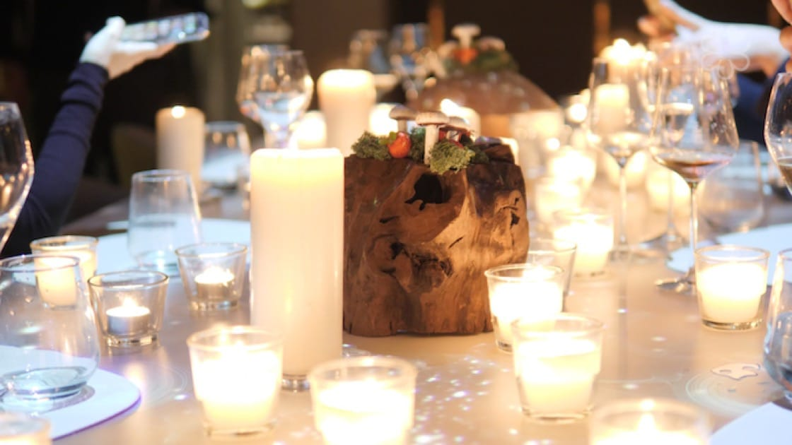 A visual spectacle of a table filled with lighted candles is a stunning curtain call to the meal.
