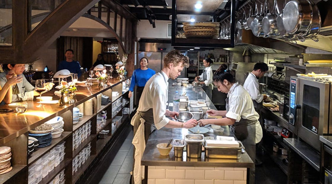 Chef Riley Sanders (left) working closely with his team at the open kitchen at Canvas, Bangkok.