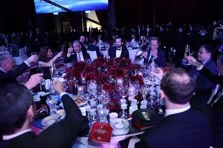 Chefs and industry veterans toast to the start of the gala dinner.