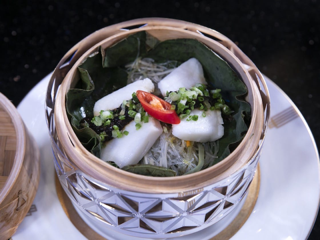 Steamed Sea Bass Fillet in Fermented Bean Sauce by Chan Yan Tak of three-Michelin-starred Lung King Heen in Hong Kong.