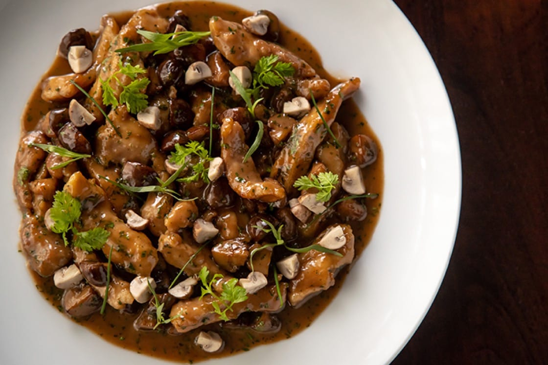 Chicken served Zurich-style with mushrooms, onions and cream sauce. (Photo by Gary He.)