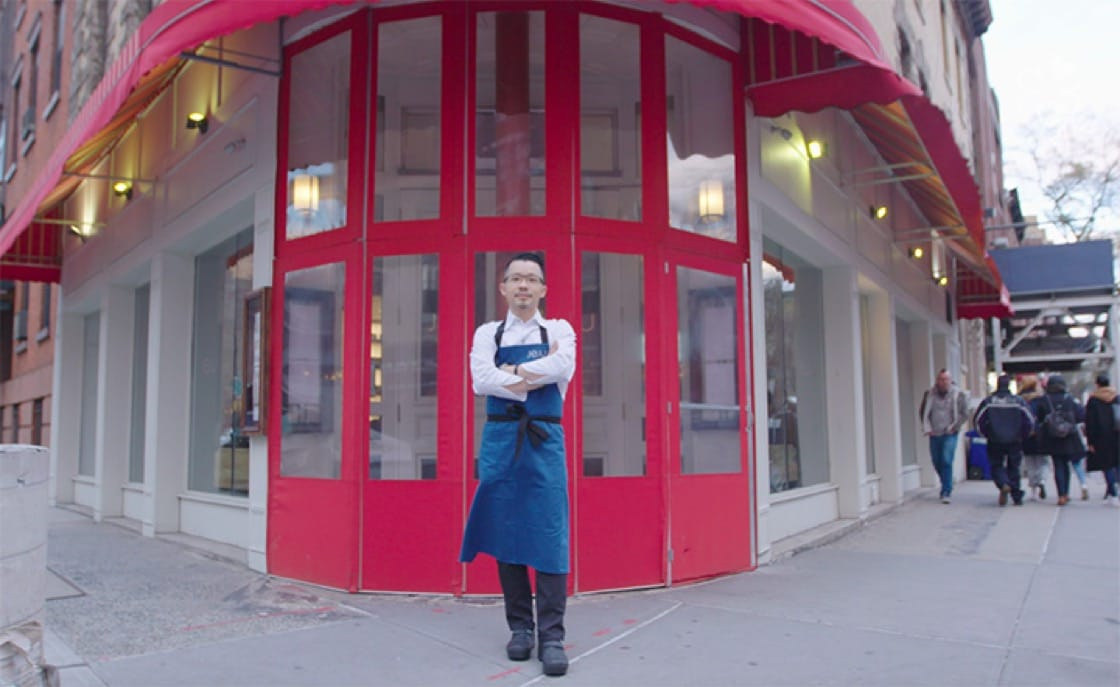 Chef/owner Douglas Kim in front of his Jeju Noodle Bar in New York City.