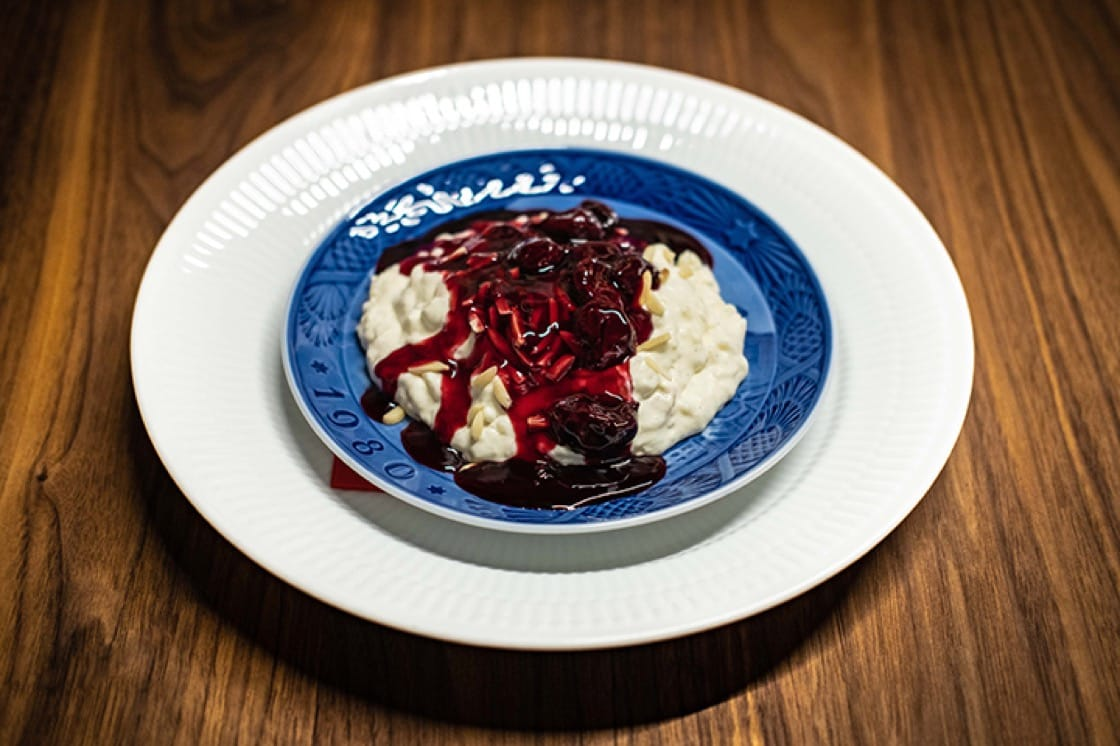 Risalamande is a cold rice porridge mixed with whipped cream, vanilla and almonds, served with hot or cold cherry sauce or compote. (Photo courtesy of Restaurant Palægade.)