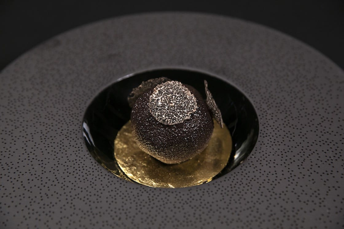 French pastry chef Pierre Hermé's Truffle dessert features a black truffle nestled in hazelnut-flavoured sponge cake. (Credit: Pierre Hermé)