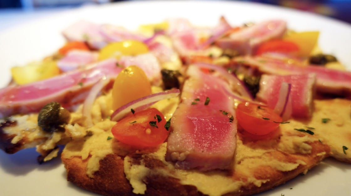 Pacific rim flavous come from a medley of cuisines from Asia-Pacific to Hawaii and one such dish include an ahi tuna hummus pizza.