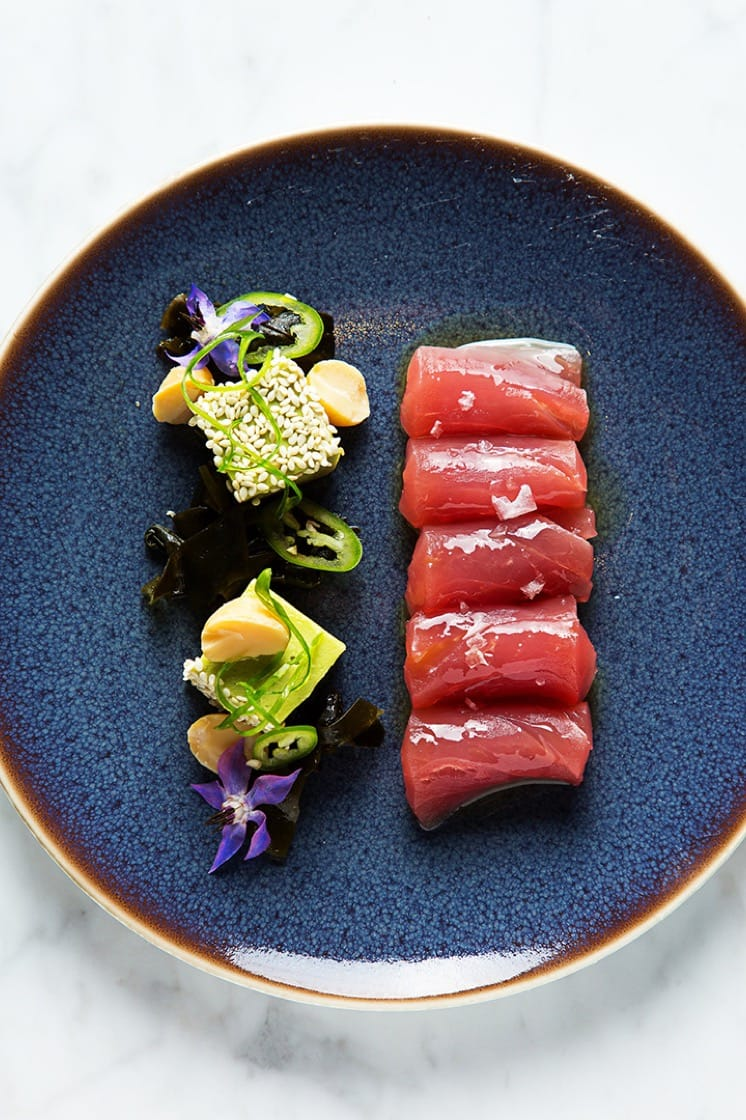 Big eye tuna with avocado mousse, wakame seaweed, macadamia nut, kalamansi lime and sesame seeds. (Photo by Scott Suchman.)