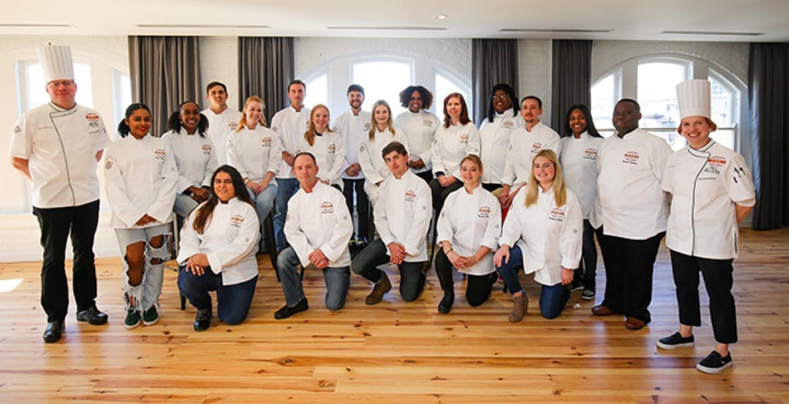 The inaugural class of NOCHI with instructors (Baking & Pastry Arts), Shawn Hanlin (Director of Education) and Allison Vines-Rushing (Culinary Arts).