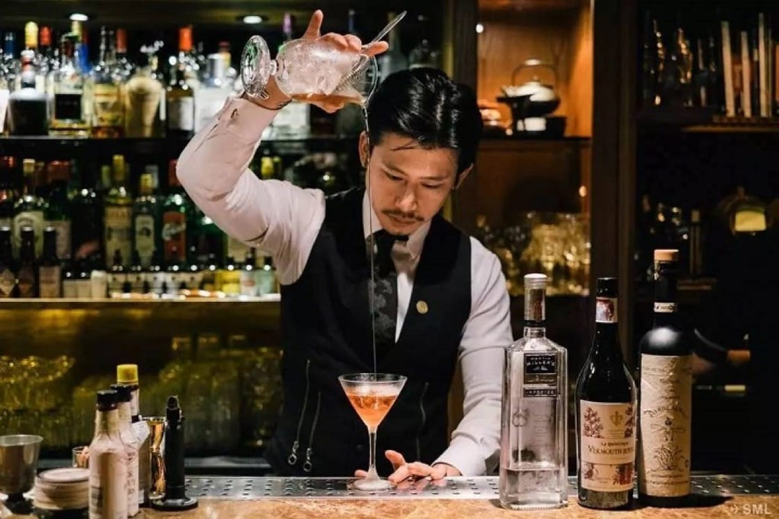 Taiwanese mixologist Angus Zou working at Alchemy, a popular speakeasy bar in Taipei.