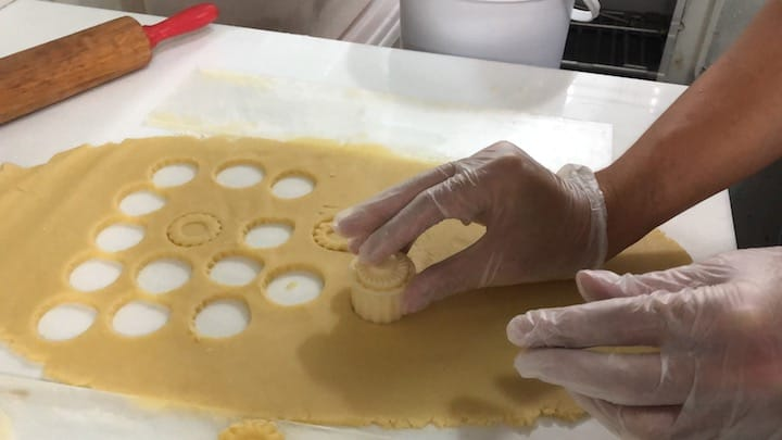 Delicate fingers are needed to mould the 2mm-thick dough sheets into flower-shaped cut-outs.