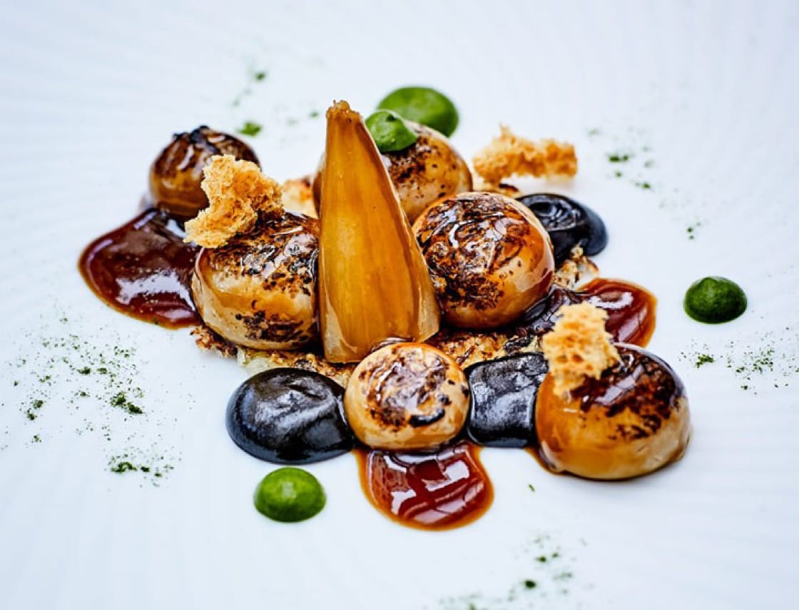 Gratineed onions at Le Cinq. (Photo by Jean-Claude Amiel.)